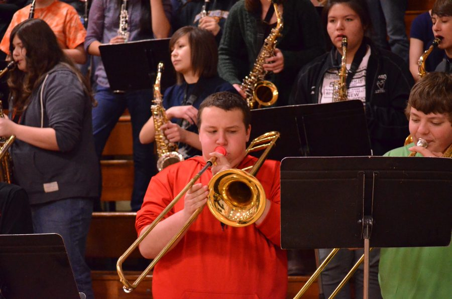 Trombone+player+Jayden+Gjerseth+performs+during+the+Snowball+assembly.