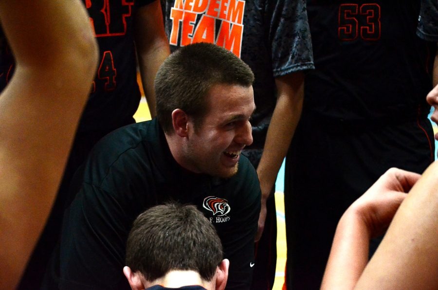 Coach Gaier huddles with his teammates after taking a strong lead in the game on Dec 10. The Tigers won against La Crescent 73-70.  Photo contributed by Lauren Helstad