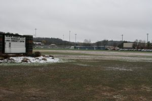 A field between the high school and State Highway 54 will be the location of a new community center.
