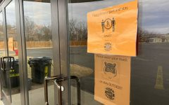 COVID signs on door outside ice arena