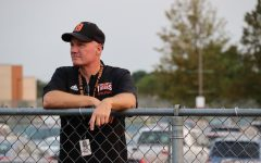 Athletic Director Jay Weinman watches over a September 15 soccer game at Tiger Field. Photo by Mia Handly.